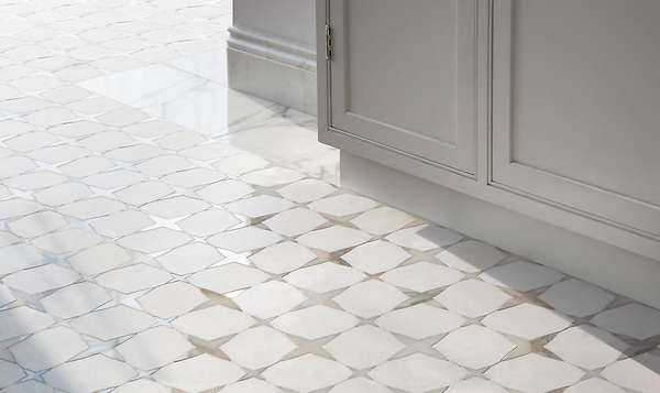 Michael, a waterjet stone mosaic, shown in honed Thassos and polished Calacatta Gold, is part of the Trove collection for New Ravenna.