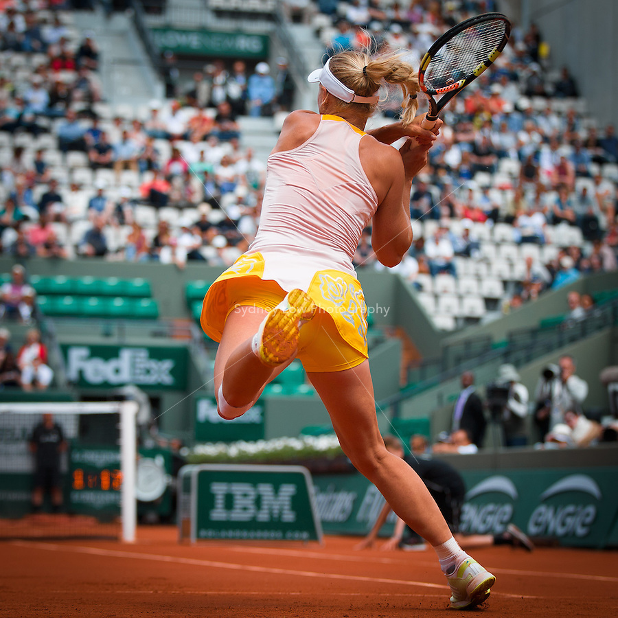 May 26, 2015: Caroline Wozniacki (DEN) in action in a 1st round match against Karin Knapp (ITA) on day three of the 2015 French Open tennis tournament at Roland Garros in Paris, France. Wozniacki won 63 60. Sydney Low/AsteriskImages