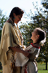Native American Indian Lakota Sioux mother laughing with her daughter