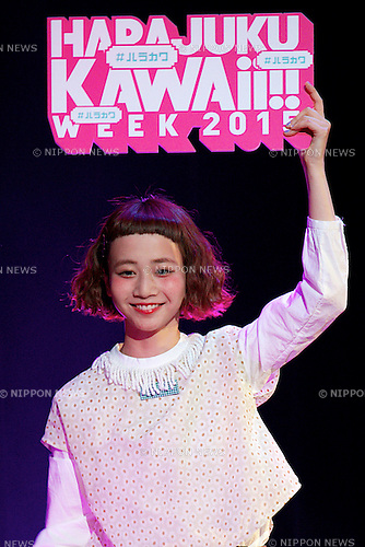 Model Natsume Mito holding a placard walks down during the catwalk of the ''Harajuku Kawaii Week'' on May 10, 2015, Tokyo, Japan. Various  famous models and idol groups attend the ''Harajuku Kawaii Week 2015'' to promotes the fashion events in Tokyo. The event was held from May 09 to 10. (Photo by Rodrigo Reyes Marin/AFLO)