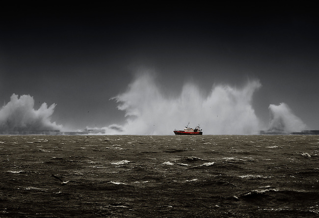 French trawler entering the harbour in Boulogne-sur-Mer, during one of the biggest storms of 2013.<br />