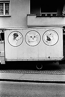 Switzerland. Canton Ticino. Lugano. A truck with the drawings of a mouse, a cat and a parrot. 20.02.08 © 2008 Didier Ruef
