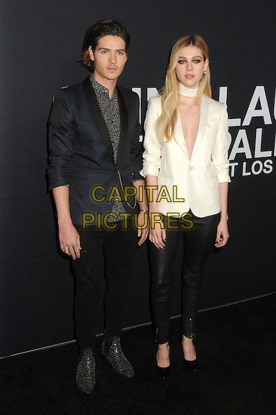 10 February 2016 - Los Angeles, California - Will Peltz, Nicola Peltz. Saint Laurent At The Palladium held at the Hollywood Palladium. <br /> CAP/ADM/BP<br /> &copy;BP/ADM/Capital Pictures