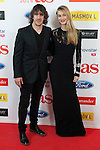 Football player Carles Puyol poses with his wife and model Vanessa Lorenzo during AS Sport Female Awards ceremony in Madrid, Spain. December 15, 2014. (ALTERPHOTOS/Victor Blanco)