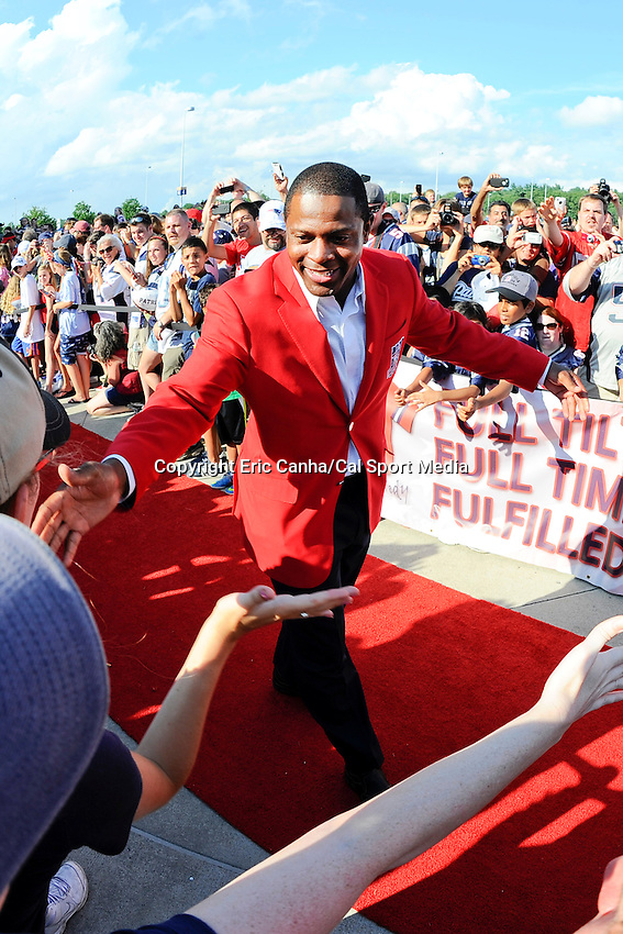 July 29, 2013 - Foxborough, Massachusetts, U.S. - Former Patriot Troy Brown walks the red carpet during New England Patriots Hall of Fame induction at Patriot Place in Foxborough Massachusetts.   Eric Canha/CSM