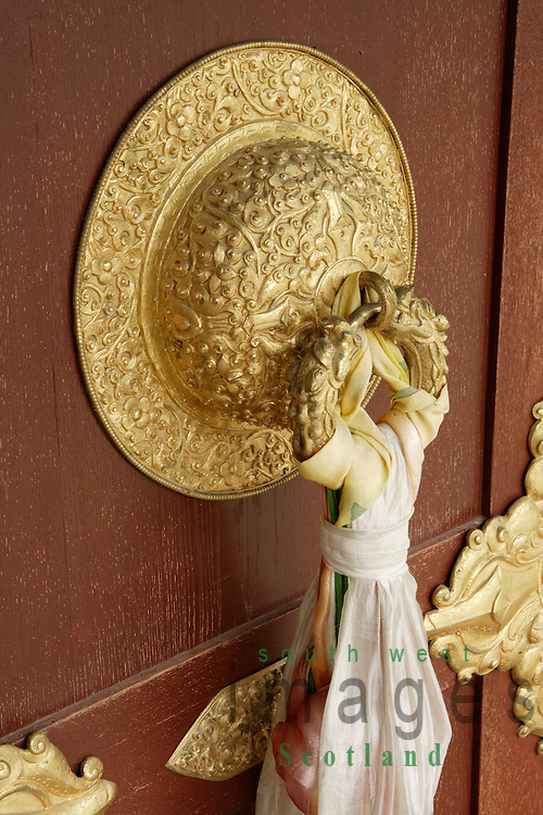 Samye Ling Monastry and Tibetan Centre Eskdalemuir near Langolm Dumfries and Galloway elaborate decoratated door knocker on outside off temple