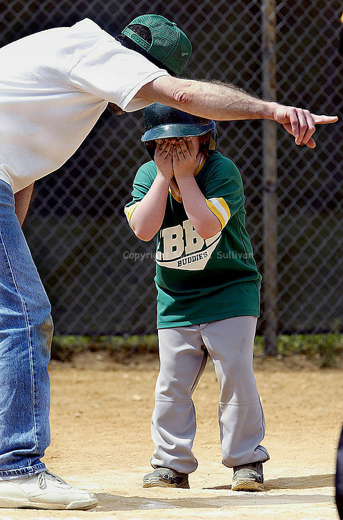 """IT'S ALRIGHT""..The East Brunswick Baseball League held it's annual Buddy Ball Baseball games at Manager's Field in East Brunswick. Teams made up of volunteers & disabled children get together for a day of great baseball. Here coach Rich Quinn tries to explain to 8 yr old Travis Price of Somerset that he needs to run to 1st base after hitting a single during the game. Don't worry everything worked out and Travis  composed himself and made it to 1st base.(MARK R. SULLIVAN)"