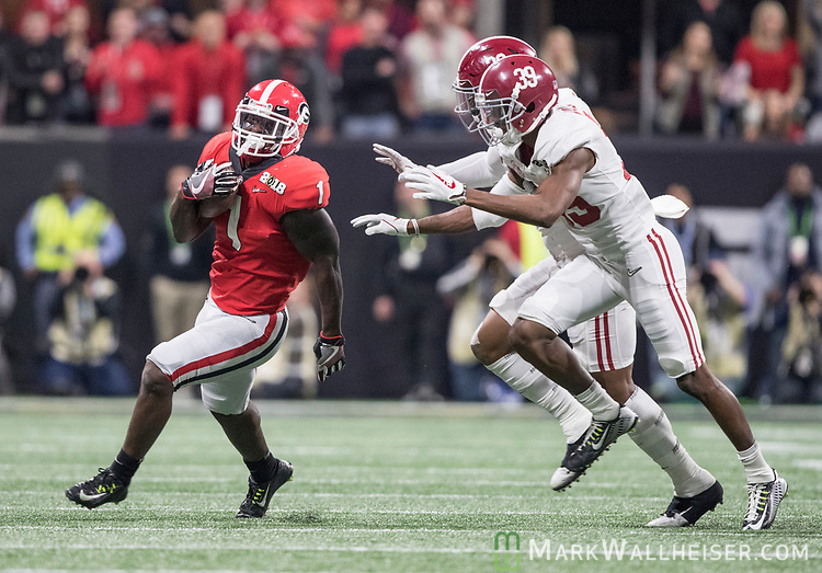 Georgia Bulldogs running back Sony Michel (1) gets outside the Alabama Crimson Tide defensive on a long run in the first quarter of the NCAA College Football Playoff National Championship at Mercedes-Benz Stadium on January 8, 2018 in Atlanta. Photo by Mark Wallheiser/UPI