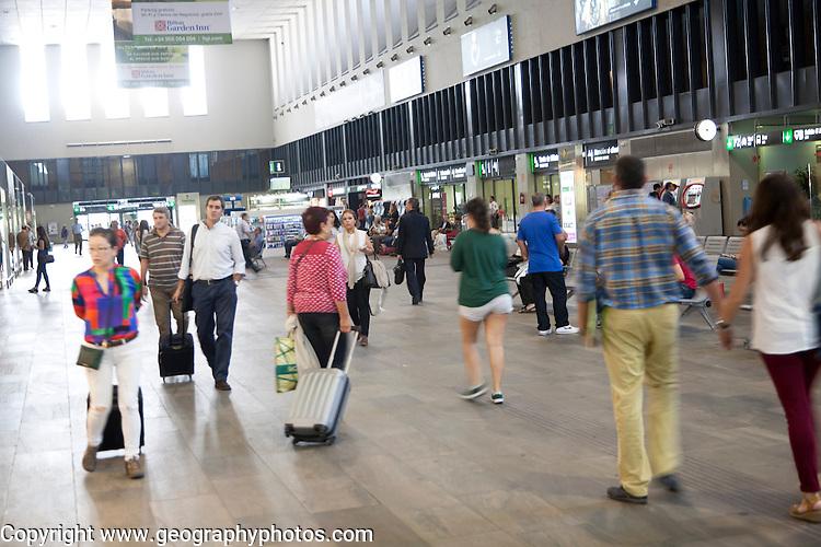 People in ticket concourse inside Santa Justa railway station Seville, Spain
