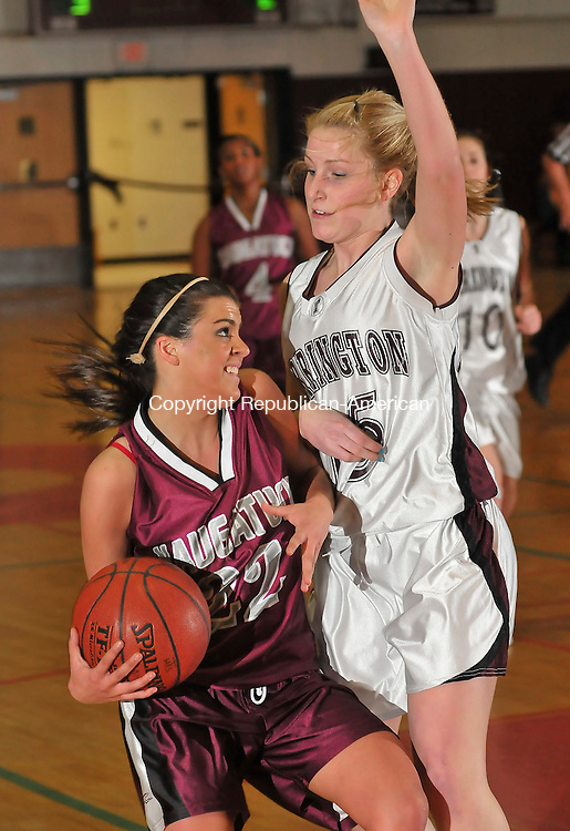 TORRINGTON, CT- 04 MARCH 2009 --030409JS08-Torrington's Katie Rougeot (15) stopps Naugatuck's Julie Longo (22) as she tries to drive to the basket during their CIAC Class L playoff game Wednesday at Torrirngton High School. <br /> Jim Shannon Republican-American