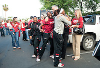 FRESNO, CA--Sisters Nneka Ogwumike and Chiney Ogwumike hug their supporters on their way to the bus before a 76-60 win over South Carolina at the Save Mart Center for the West Regionals semifinals of the 2012 NCAA Championships.