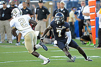 17 September 2011:  FIU safety Jonathan Cyprien (7) pursues UCF quarterback Jeff Godfrey (2) in the first quarter as the FIU Golden Panthers defeated the University of Central Florida Golden Knights, 17-10, at FIU Stadium in Miami, Florida.