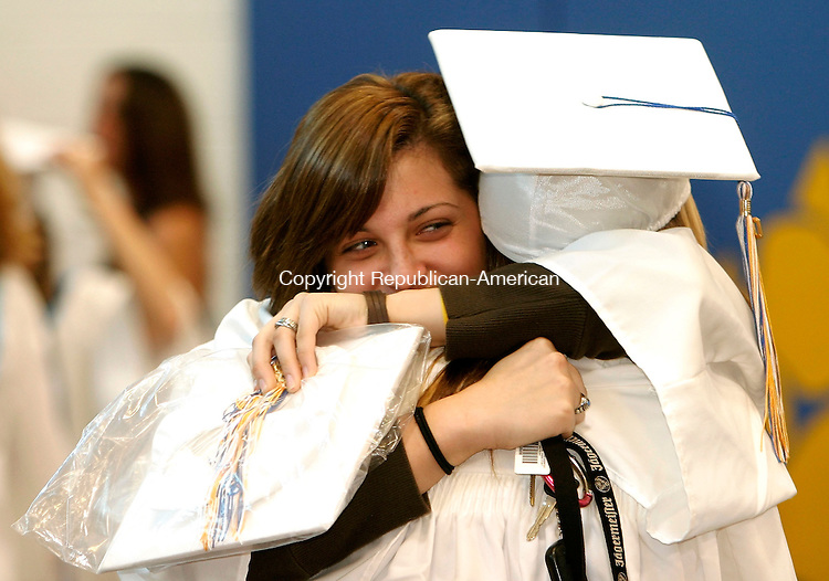 SEYMOUR, CT - 17 JUNE 2005 -061705JS02--Seymour graduating senior Taylor Matejek gives classmate Kaitlin Tichy a hug prior to commencement Friday at Seymour High School.  --Jim Shannon Photo--Kaitlin Tichy; Seymour, Taylor Matejek are CQ