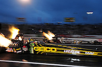 Jun. 1, 2012; Englishtown, NJ, USA: NHRA top fuel dragster driver Morgan Lucas (near lane) races alongside Shawn Langdon during qualifying for the Supernationals at Raceway Park. Mandatory Credit: Mark J. Rebilas-