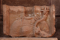 Lower Temenos limestone plaster block of a woman holding a  cornucopia, from Great Temple, Petra, Ma'an, Jordan. This is a relief sculpture of the bust of a female wearing a chiton over one shoulder and holding a cornucopia in her left hand. Deep chisel marks define the folds in her clothing. 1st century BC - 2nd century AD. Petra was the capital and royal city of the Nabateans, Arabic desert nomads. Picture by Manuel Cohen