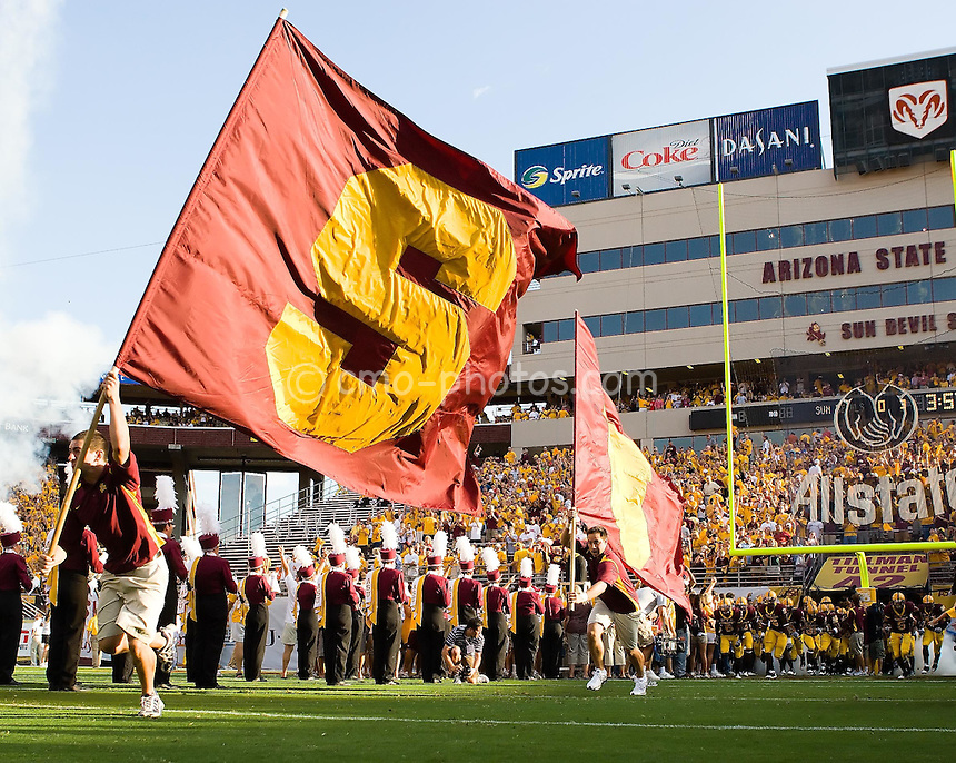 Sept 20, 2008; Tempe, AZ, USA; Arizona State Sun Devils Cheerleaders lead their team onto the field prior to a game against the Georgia Bulldogs at Sun Devil Stadium.  Georgia beat Arizona State 27-10.