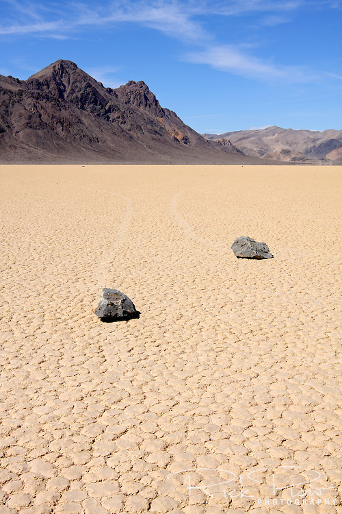 The Grandstand rock formation on Death Valley's Racetrack Playa. Racetrack Playa is a seasonally dry lake (a playa) located in the northern part of the Panamint Mountains nestled between the Cottonwood Mountains to the east and the Last Chance Range to the west in Southeastern California. The Racetrack Playa is known for its 'sailing stones' which are rocks that mysteriously move across its surface.