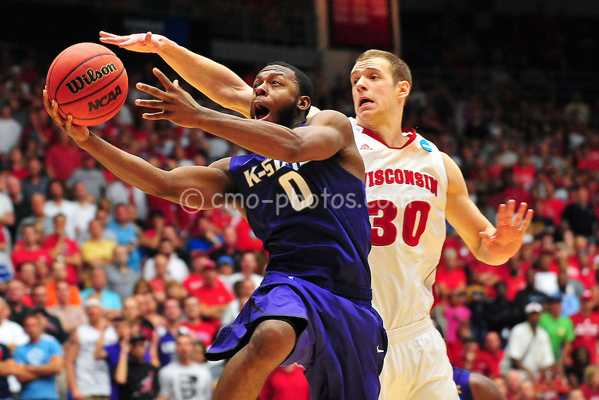 Mar 19, 2011; Tucson, AZ, USA; Kansas State Wildcats guard Jacob Pullen (0) shoots in front of Wisconsin Badgers forward Jon Leuer (30) in the second half of a game in the third round of the 2011 NCAA men's basketball tournament at the McKale Center.  The Badgers won 70-65.