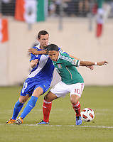Mexico Giovani Dos Santos (10) shields the ball against Gatemala Jose Del Aguila (19)   Mexico defeated Guatemala 2-1 in the quaterfinals for the 2011 CONCACAF Gold Cup , at the New Meadowlands Stadium, Saturday June 18, 2011.