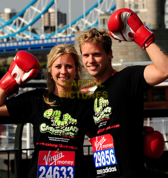 HOLLY & SAM BRANSON.Virgin London Marathon - photocall, .Tower Suite Three, The Tower Hotel, .London, England, UK, April 23rd 2010..half length red boxing gloves black t-shirt  brother sister family siblings arms arm raised up pose.CAP/CJ.©Chris Joseph/Capital Pictures