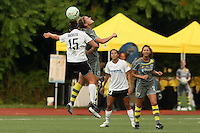magicjack midfielder, Amanda DaCosta (15) and Philadelphia midfielder, Jen Buczkowski (4) compete for a header, as teammates Christen Press (23) and Estelle Johnson (24) look on.  With five different players scoring, the Philadephia Independence overpowered magicjack, 6-0 on June 18th at Widener University in Chester, PA.