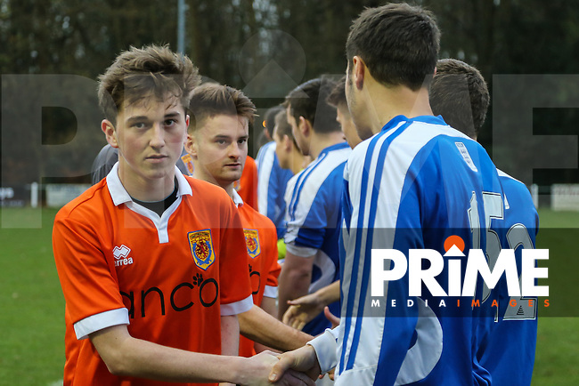 Players shake hands ahaead of the Ampthill Town v Flitwick Town match in the Beds Senior Trophy Quarter Final at Ampthill Stadium, Bedfordshire, England on 12 December 2015. Photo by David Horn/PRiME Media Images