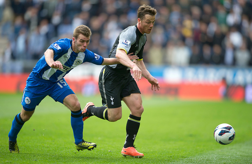 Tottenham Hotspur's Scott Parker battles with Wigan Athletic's Callum McManaman .. - (Photo by Stephen White/CameraSport) - ..Football - Barclays Premiership - Wigan Athletic v Tottenham Hotspur - Saturday 27th April 2013 - DW Stadium - Wigan..© CameraSport - 43 Linden Ave. Countesthorpe. Leicester. England. LE8 5PG - Tel: +44 (0) 116 277 4147 - admin@camerasport.com - www.camerasport.com