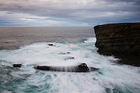 Stormy seas crash against dramatic coastal cliffs at Yesnaby, Orkney, Scotland