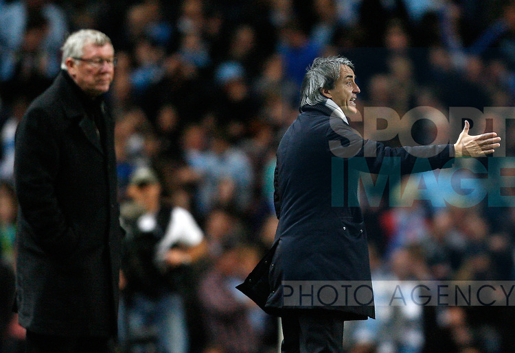 Manchester City's manager Roberto Mancini (R) and Manchester United's manager Sir Alex Ferguson..Barclays Premier League match between Manchester City and Manchester United at the Etihad Stadium, Manchester on the 30th April 2012..Sportimage +44 7980659747.picturedesk@sportimage.co.uk.http://www.sportimage.co.uk/.