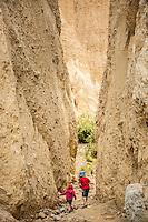 Children (girl 4 years boy 6 years) exploring the Clay Cliffs near Omarama, Canterbury, New Zealand - stock photo, canvas, fine art print