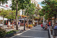 Pedestrian street, Estepona, Malaga Province, Spain, Espa&ntilde;a, October, 2018, 2018100815<br /><br />Copyright Image from Victor Patterson, 54 Dorchester Park, <br />Belfast, UK, BT9 6RJ<br /><br />t1: +44 28 9066 1296 (from Rep of Ireland 048 9066 1296)<br />t2: +44 28 9002 2446 (from Rep of Ireland 048 9002 2446)<br />m: +44 7802 353836<br /><br />victorpattersonbelfast@gmail.com<br /><br />Please see my Terms and Conditions of Use at victorpatterson.com. It is IMPORTANT that you familiarise yourself with them.<br /><br />Images used on the Internet incur an additional cost and must be visibly watermarked i.e. &copy; Victor Patterson within the body of the image and copyright metadata must not be deleted. Images used on the Internet have a size restriction of 4kbs and are chargeable at rates available at victorpatterson.com.<br /><br />This image is available only for the use of the download recipient i.e. television station, newspaper, magazine, book publisher, etc, and must not be passed on to any third party. It is also downloaded on condition that each and every usage is notified within 7 days to victorpattersonbelfast@gmail.com<br /><br />The right of Victor Patterson (or the named photographer) to be identified as the author is asserted in accordance with The Copyright Designs And Patents Act (1988). All moral rights are asserted.
