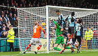 Paris Cowan-Hall of Wycombe Wanderers heads past the keeper but is ruled to have fouled him  during the Sky Bet League 2 match between Wycombe Wanderers and Luton Town at Adams Park, High Wycombe, England on 6 February 2016. Photo by Massimo Martino.