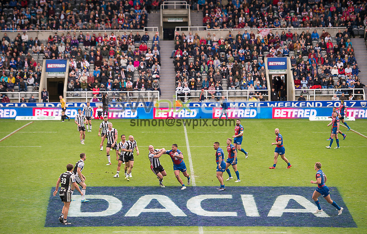 Picture by Allan McKenzie/SWpix.com - 20/05/2017 - Rugby League - Dacia Magic Weekend - St James' Park, Newcastle, England - The brief, Dacia, Betfred, branding, David Fifita fends off a Widnes player.