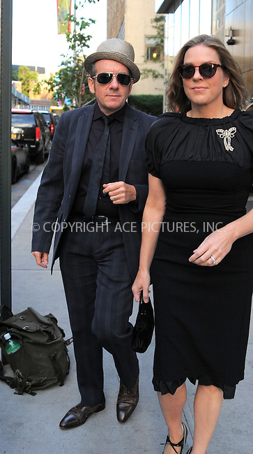 WWW.ACEPIXS.COM....September 5 2012, New York City....Musician Elvis Costello and his wife Diana Krall leave a Soho hotel on September 5 2012 in New York City......By Line: Curtis Means/ACE Pictures......ACE Pictures, Inc...tel: 646 769 0430..Email: info@acepixs.com..www.acepixs.com