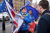 Pro and anti-Brexit protesters argue outside the Houses of Parliament as MPs debate the government's Brexit deal, Westminster, London.