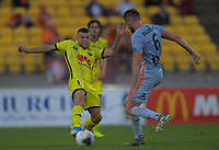 Phoenix's Jaushua Sotirio tackles Brisbane's Macauley Gillesphey during the A-League football match between Wellington Phoenix and Brisbane Roar at Westpac Stadium in Wellington, New Zealand on Saturday, 23 November 2019. Photo: Dave Lintott / lintottphoto.co.nz