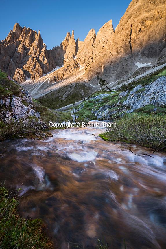 Stream rushing through high country in Dolomite Range, Italy.