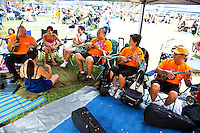 Festival organizers hang out under the tent at the 40th Annual Ukulele Festival at Kapiolani Park
