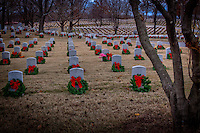 Today Dec. 12, 2009 citizens of Fort Smith honored the servicemen and women of our community, who have made the ultimate sacrifice for nation. Family, friends and volunteers transformed the Fort Smith National Cemetery by placing one wreath on each of the 12,000 headstones in their honor.<br /> <br /> The &quot;Christmas Honors&quot; was derived from Wreaths Across America where as part of the program, the Arlington National Cemetery&rsquo;s gravesites are decorated every Christmas season with wreaths with red ribbons to honor those who have given their lives to provide the freedoms we enjoy in our beloved Nation. The cemetery is transformed into a vision of beauty, and the families of those buried at Arlington take comfort in seeing the respect that is shown to their grandfathers, fathers, mothers, sons, daughters, brothers, sisters, friends and other fallen heroes who so loved our Country.