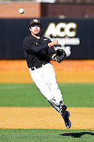 Shortstop Pat Blair #11 of the Wake Forest Demon Deacons makes an off balance throw to first base during an intrasquad scrimmage at Wake Forest Baseball Park on January 29, 2012 in Winston-Salem, North Carolina.  (Brian Westerholt / Four Seam Images)