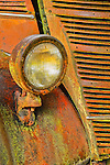 closeup of headlight on rusty old truck