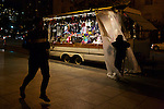 A street vendor, who refused to give his name but says he has worked in D.C. for the past 20 years, closes up shop for the night on 15th Street NW on Wednesday, November 7, 2012 in Washington, D.C.