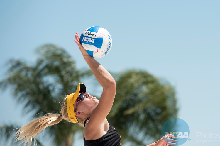 GULF SHORES, AL - MAY 07: Nicolette Martin (35) of the University of Southern California serves the ball againstPepperdine University during the Division I Women's Beach Volleyball Championship held at Gulf Place on May 7, 2017 in Gulf Shores, Alabama.The University of Southern California defeated Pepperdine 3-2 to claim the national championship. (Photo by Stephen Nowland/NCAA Photos via Getty Images)