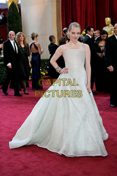 AMANDA SEYFRIED.82nd Annual Academy Awards - Oscars.Kodak Theatre, Hollywood, California, USA.7th March 2010.arrivals full length Armani prive strapless princess gown dress hand on hip white grey gray off long maxi.CAP/JE  .©James Eden/Capital Pictures.