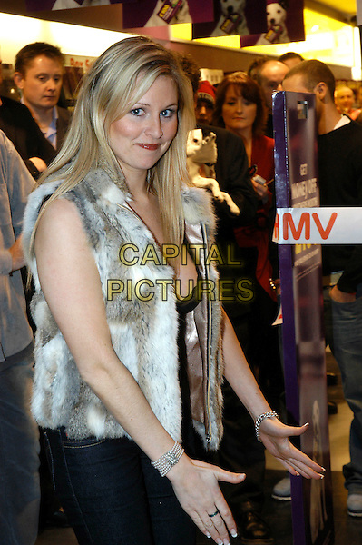 ABI TITMUSS.Opening HMV Store in Chelmsford. .half length, fur vest, hands, gesture.www.capitalpictures.com.sales@capitalpictures.com.©Capital Pictures