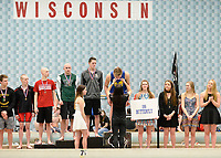 Madison West's Lain Weaver is presented his medal for winning the 100-yard butterfly during the Wisconsin Division 1 state championship swimming and diving meet at the UW Natatorium on Saturday, 2/17/18 in Madison