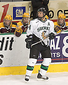 Chris Porter in front of Ryan Stoa, Phil Kessel, Justin Bostrom - The University of Minnesota Golden Gophers defeated the University of North Dakota Fighting Sioux 4-3 on Saturday, December 10, 2005 completing a weekend sweep of the Fighting Sioux at the Ralph Engelstad Arena in Grand Forks, North Dakota.