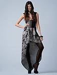 Beautiful brunette fashion model in black & silver dress and black heels