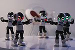 """Communication robots called """"Robi"""" perform a dance during a press preview for """"Robi cafe,"""" where visitors can interact with the robots while enjoying meals and drinks in Tokyo, Thursday, January 15, 2015. The robot can be built by assembling parts sent along with a weekly magazine by Deagostini. The cafe will open from January 16 until February 8. (Photo by Yuriko Nakao/AFLO)"""