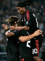 Calcio, Serie A: Lazio vs Milan. Roma, stadio Olimpico, 22 settembre 2010..Football, Italian serie A: Lazio vs AC Milan. Rome, Olympic stadium, 22 september 2010..AC Milan forward Zlatan Ibrahimovic, of Sweden, left, celebrates with teammates Kevin Prince Boateng, center, and Ronaldinho, after scoring..UPDATE IMAGES PRESS/Riccardo De Luca
